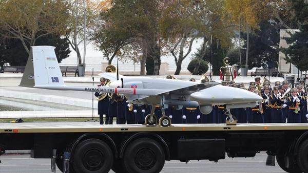 Foto - TÜRKİYE'NİN ÜLKE SINIRLARI DIŞINDAKİ VARLIĞI Askeri geçit töreninde Türkiye'nin ürettiği İnsansız Hava Araçları'nın (İHA) yer aldığı, Erdoğan'ın burada yaptığı konuşmada,