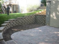 Retaining Wall with Caps and a Paver Patio installed in