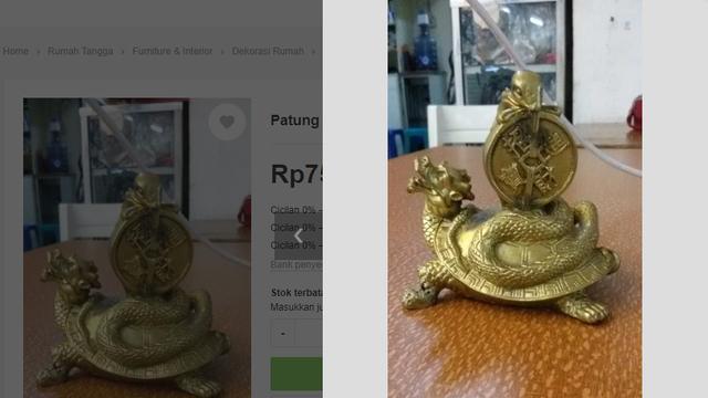 Patung kura-kura berlilit ular