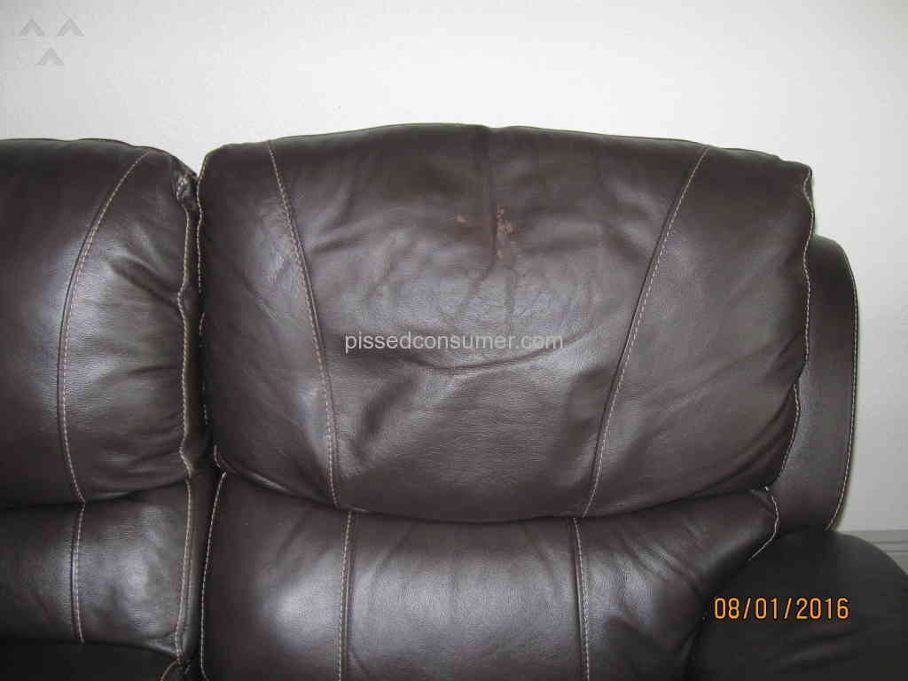 my leather chair is peeling damask accent genuine sofa from el dorado furniture aug