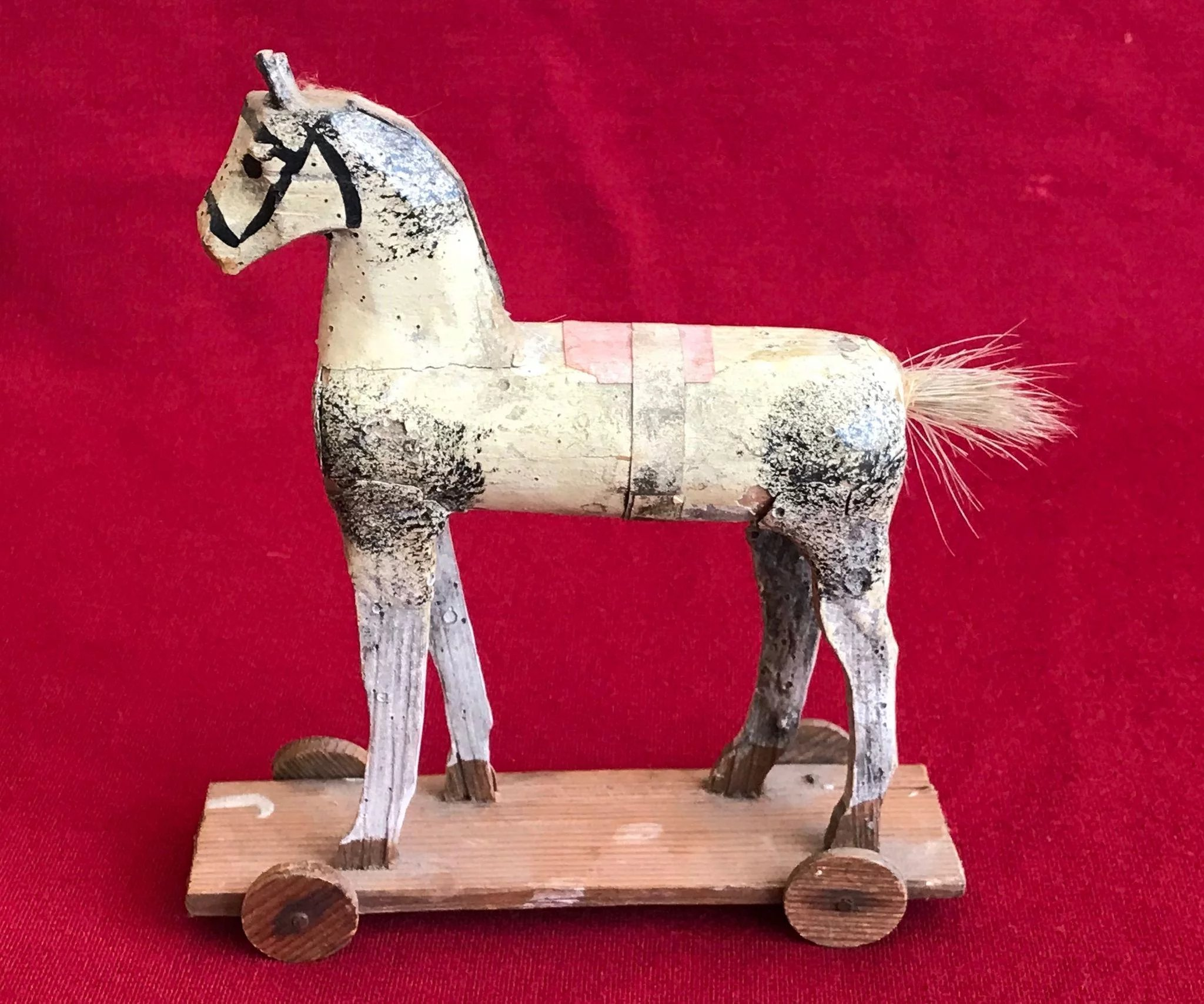 A small painted wooden horse on wheeled platform : The Toy Shop   Ruby Lane