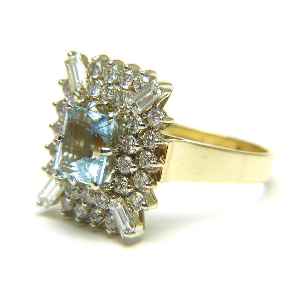 Emerald Cut Aquamarine and Diamond 14 Karat Gold Ring from