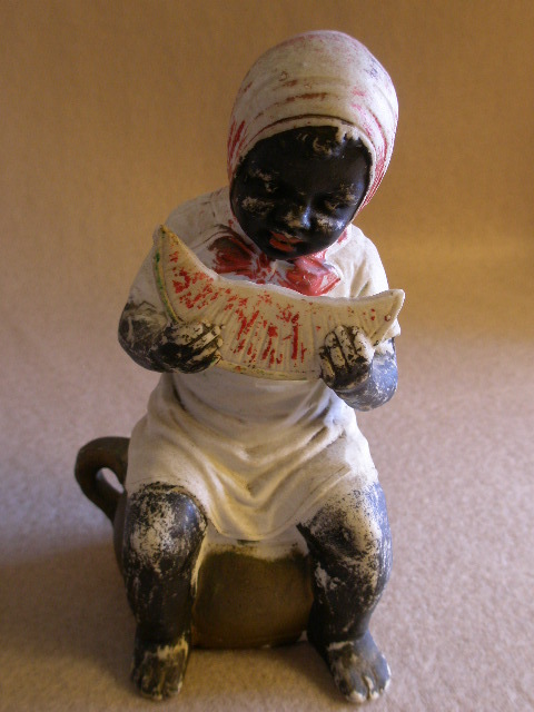 Black Americana Figurine  Girl on Chamber Pot Eating