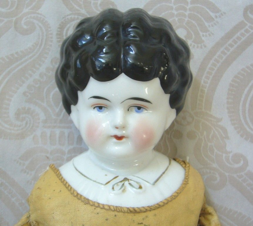 Hertwig German Glazed Porcelain China Head Doll with Blouse Detail from joanlynetteantiquedolls