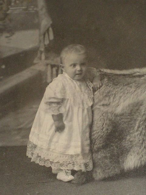Victorian Cabinet Card with Baby Girl Standing Next to Fur