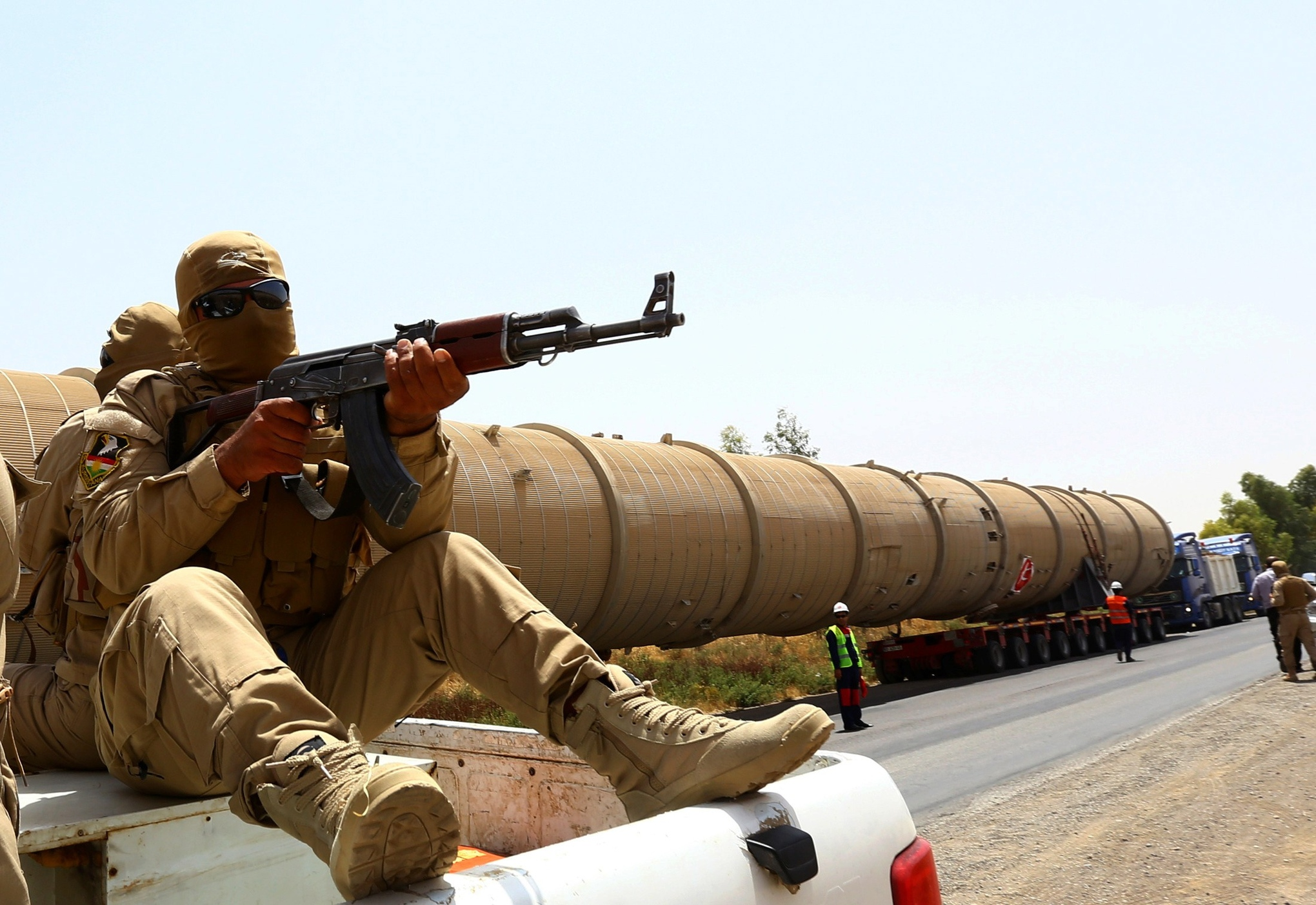 A guard at a Kurdish oil refinery. Safin Hamed/AFP/Getty Images