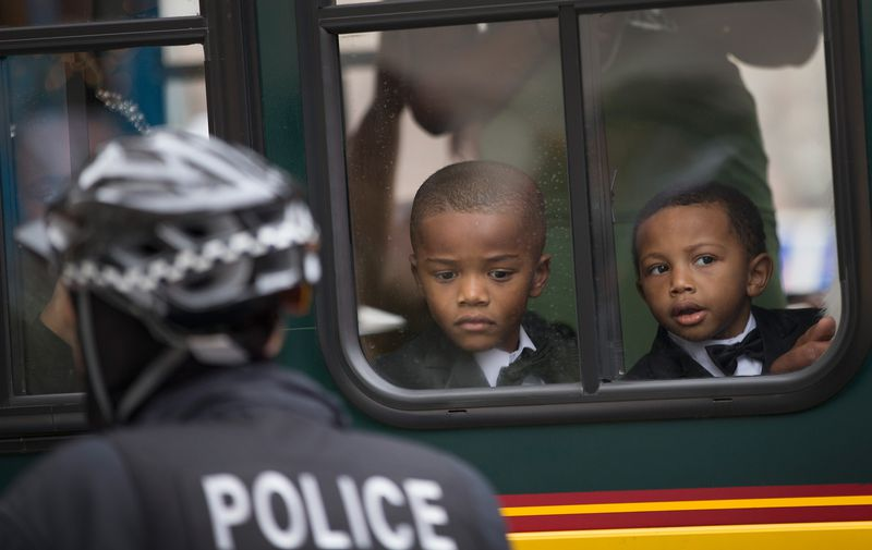 Young boys watch a protest in Chicago.