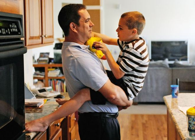 Seven-year-old Connor talks to his father David Bukovinsky as they get ready to start their day.