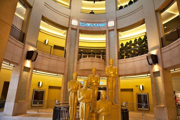 Oscar statues clustered inside the lobby of the Dolby Theatre.