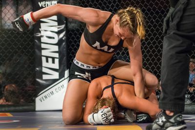 Andrea Lee lands ground in pound against Ariel Beck at Legacy 49 in 2015.