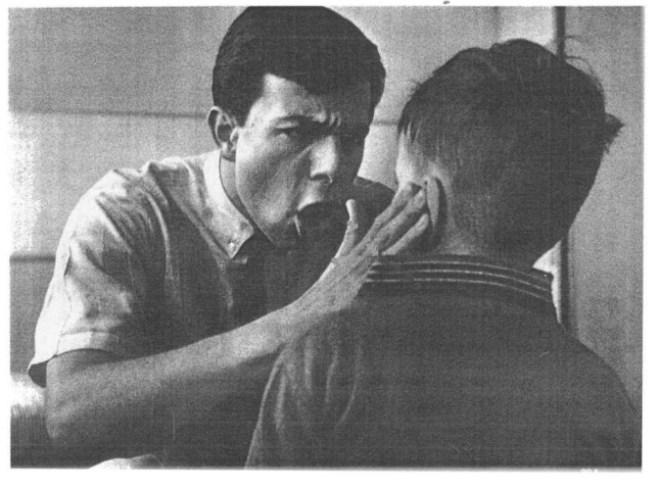 A researcher slaps a boy