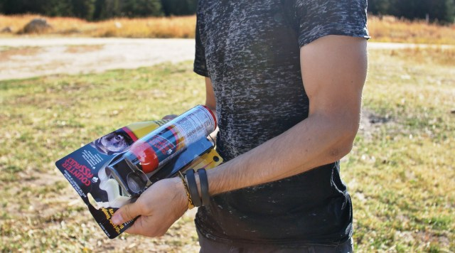 Zachary opening a package containing bear spray.