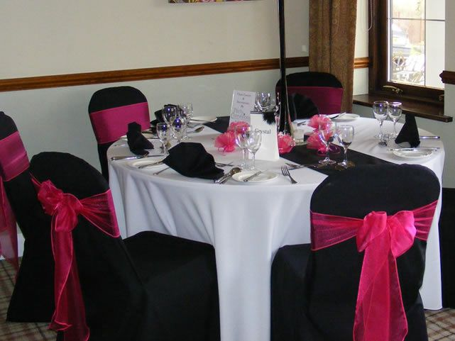 chair covers morecambe diy cushions events by design beam swagging at bartle hall black hot pink organza bows