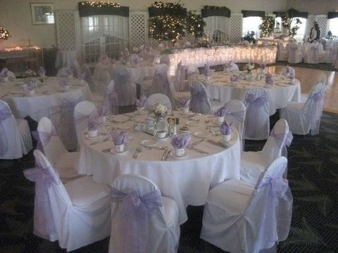 chair cover rentals halifax teal adirondack chairs plantation golf club venue ormond beach fl weddingwire cream table setting lavender ribbons