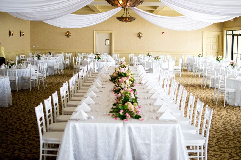 chair cover rentals gainesville fl black leather club party time event ocala weddingwire beautiful white fabric draped over the head table
