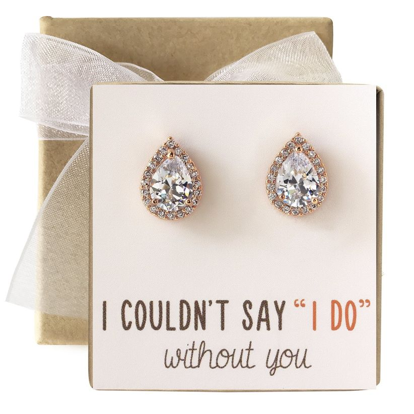 a pair of crystal stud earrings on a gift card that reads