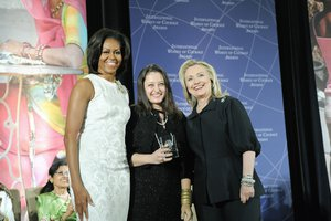 U.S. Secretary of State Hillary Rodham Clinton, right; and First Lady Michelle Obama, left; pose for a photo with 2012 International Women of Courage (IWOC) Award Winner Jineth Bedoya Lima of Colombia, at the U.S. Department of State in Washington, D.C., on March 8, 2012