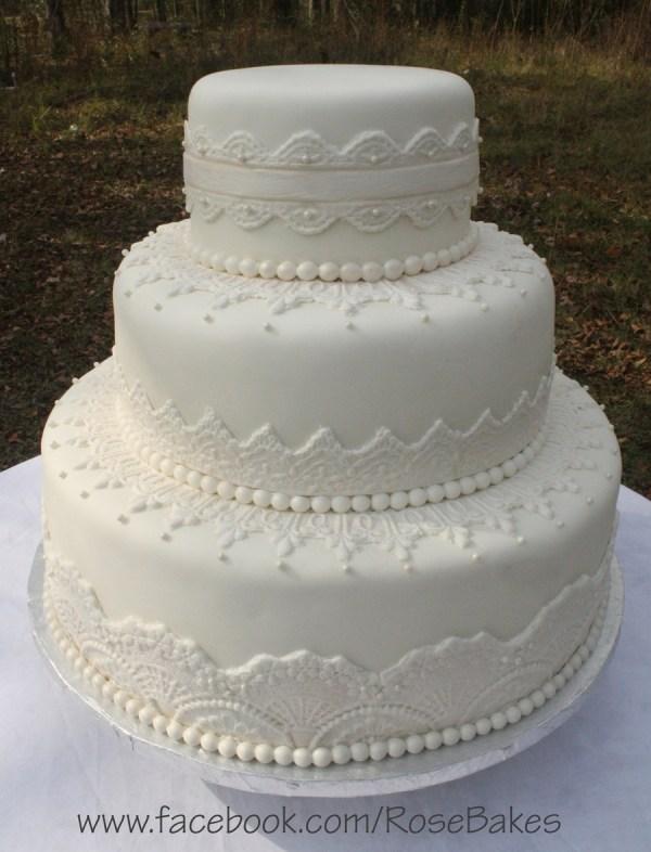 Elegant White Lace & Pearls Wedding Cake