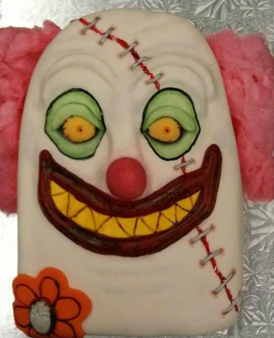 creepy clown with staples