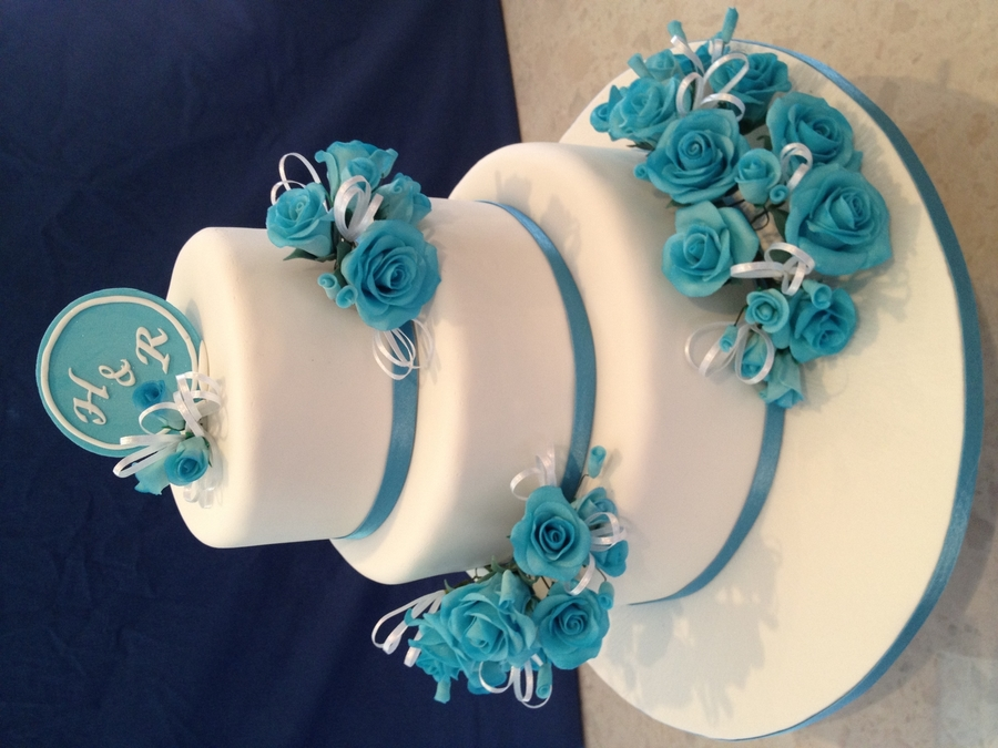 White Round Wedding Cake With Blue Flowers