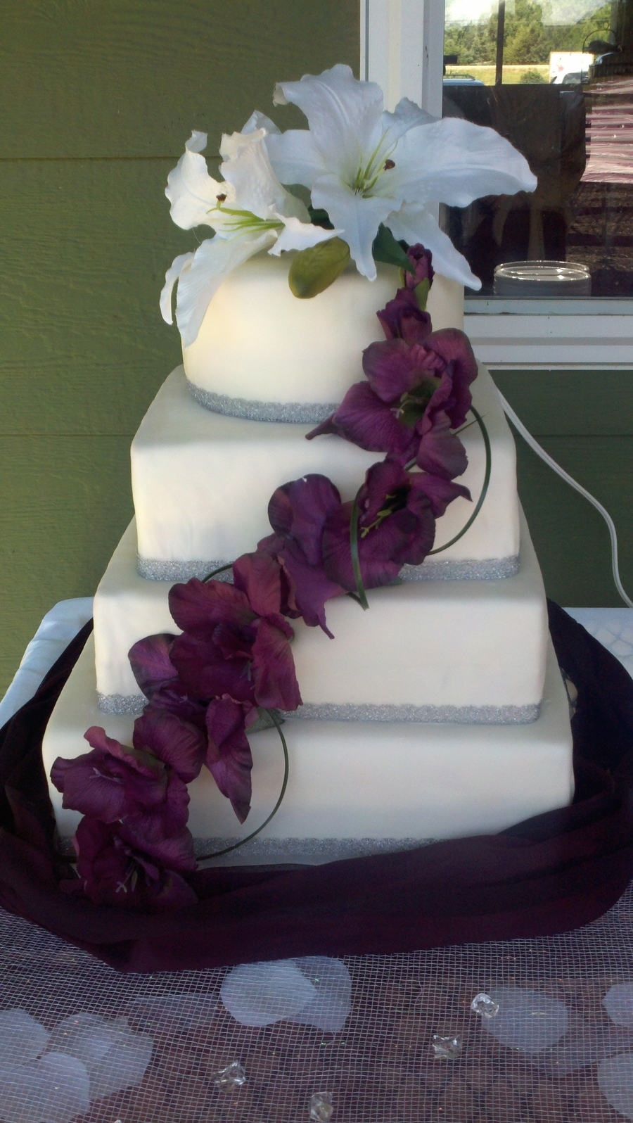 Square And Round Wedding Cake With White And Purple