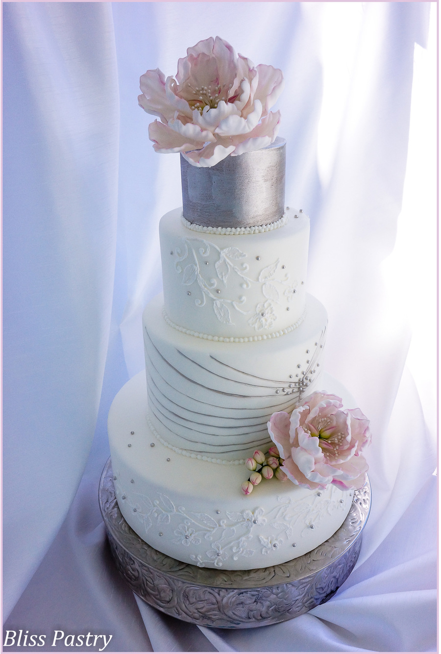 White And Silver Wedding Cake  CakeCentralcom