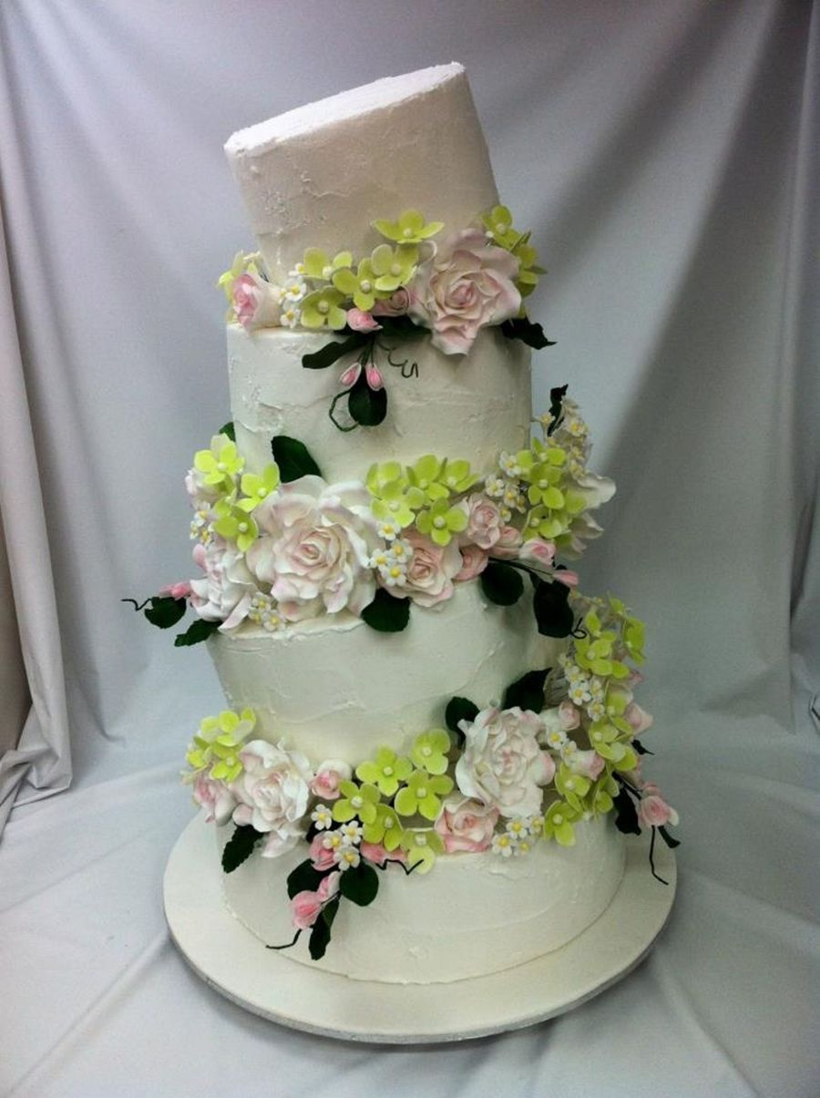 Four Tier Topsy Turvy Wedding Cake With Sugar Flowers