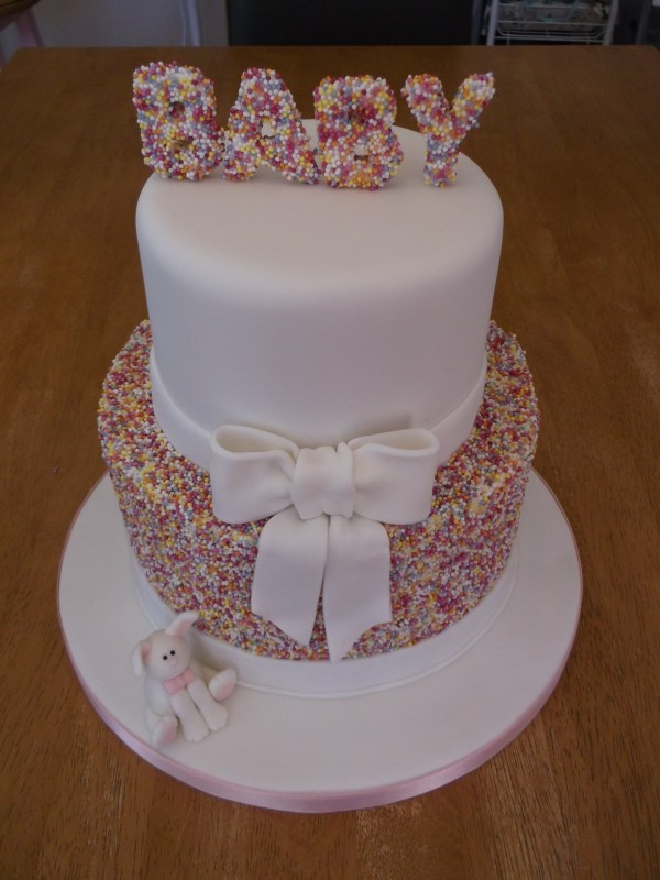 Two Tier Sprinkles Cake With Fondant Ribbon And Little