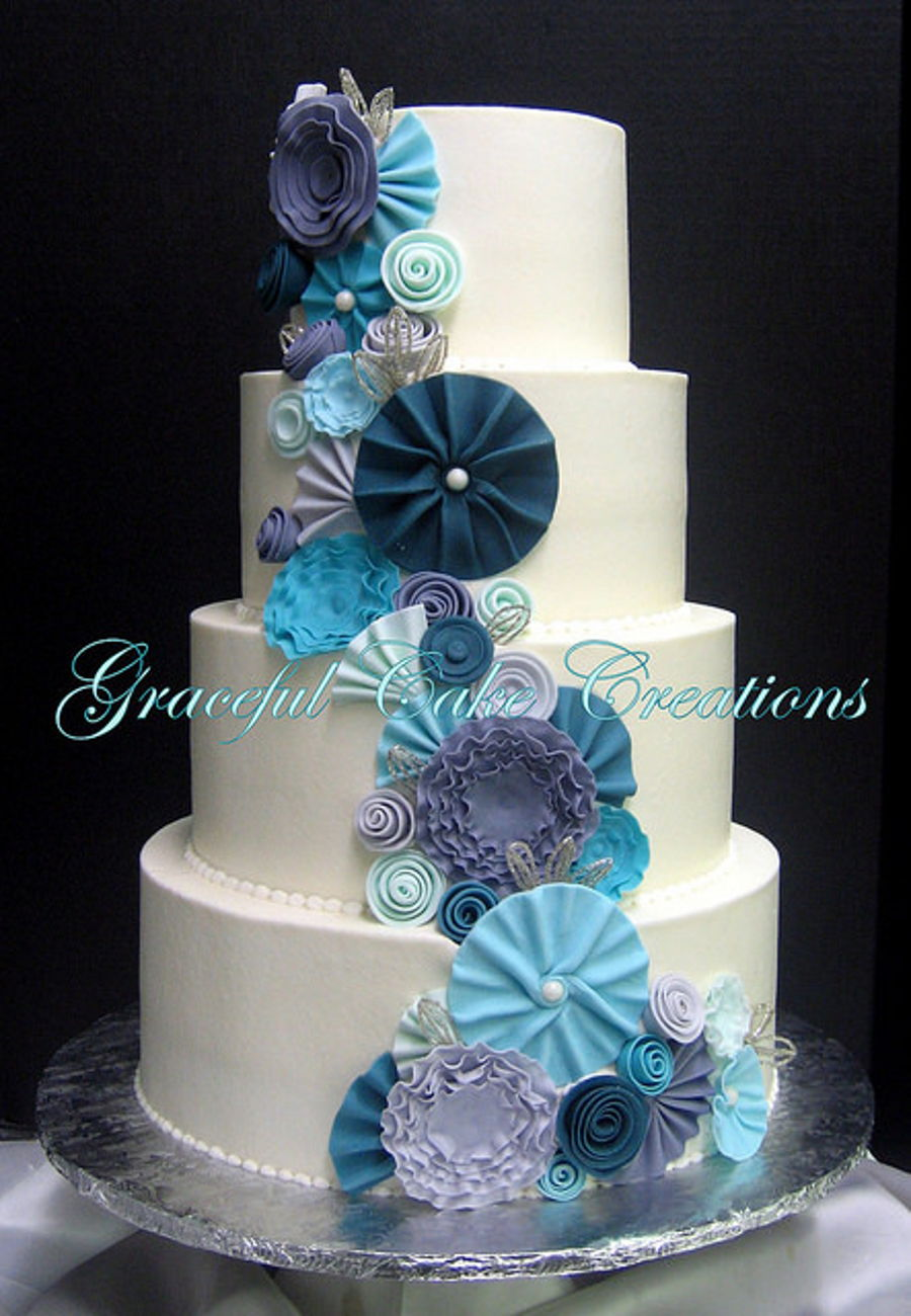 Elegant White Wedding Cake With Whimsical Fondant Flowers