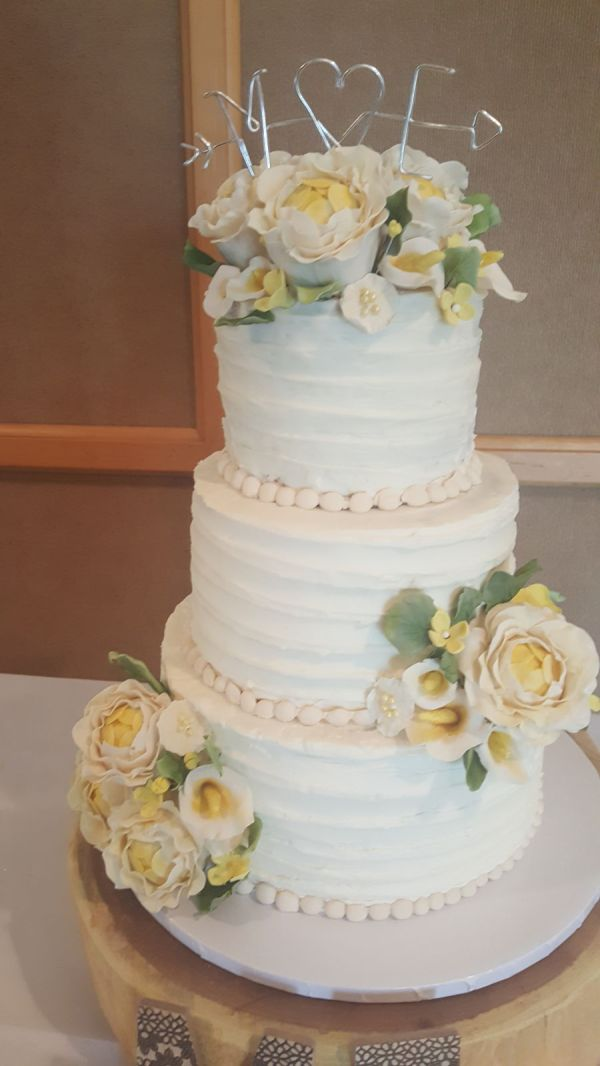 Ivory Wedding Cake With Yellow Accents And Ribbon Textured