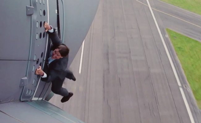 Tom Cruise Hangs Off A Plane In Crazy Mission Impossible
