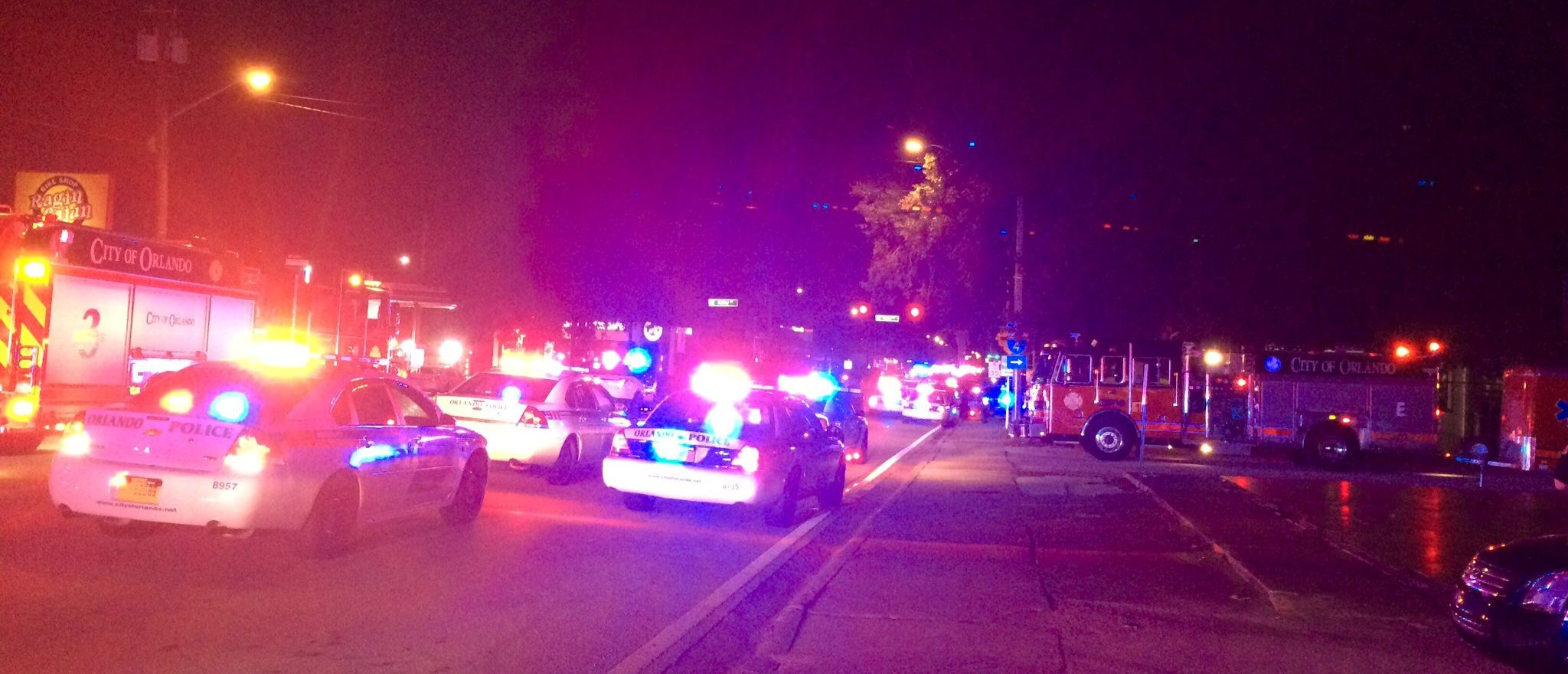 Police cars and fire trucks are seen outside the Pulse night club where police said a suspected gunman left multiple people dead and injured in Orlando, Florida, June 12, 2016. Orlando Police Department/Handout via REUTERS