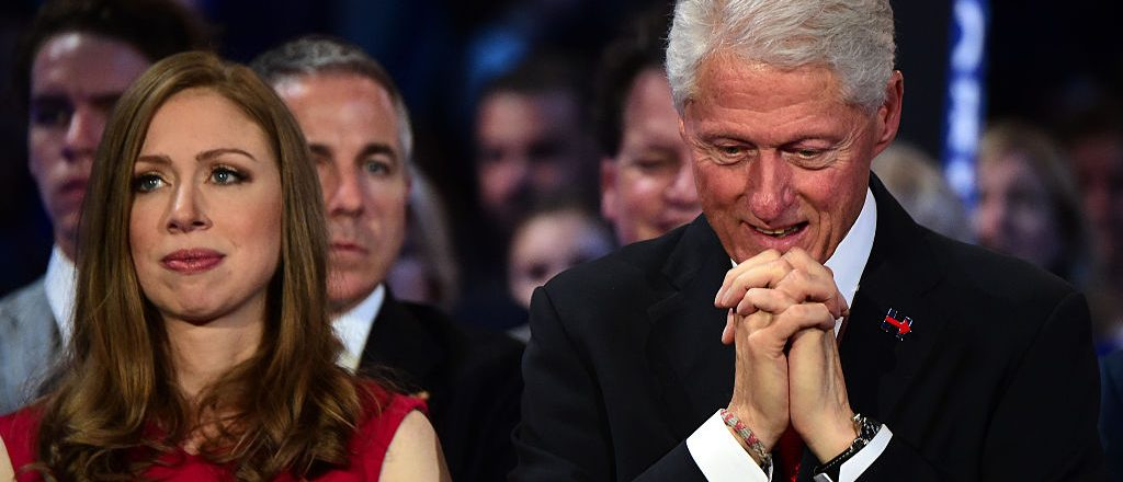 Bill Clinton and Chelsea Clinton, listen to Presedential Candidite Hillary Clinton speak on the last day of the Democratic National Convention at the Wells Fargo Center, July 28, 2016 in Philadelphia, Pennsylvania. / AFP / Robyn BECK (Photo credit should read ROBYN BECK/AFP/Getty Images)