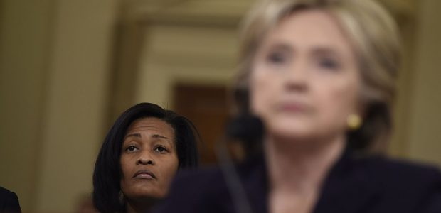 Cheryl Mills sits behind Hillary Clinton as the former secretary of state testifies before Congress in 2015 (Getty Images)