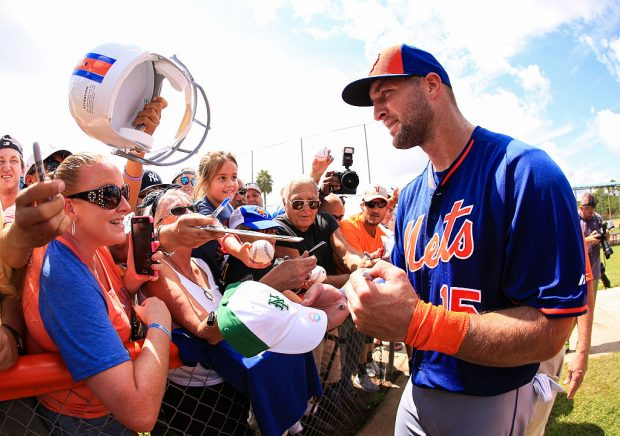 Tebow signs autographs for fans at Instructional League play (Photo credit: Getty Images)
