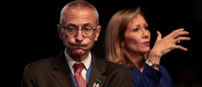Hillary Clinton's Campaign Chairman John Podesta looks on prior to the start of the Presidential Debate at Hofstra University (Photo by Drew Angerer/Getty Images)