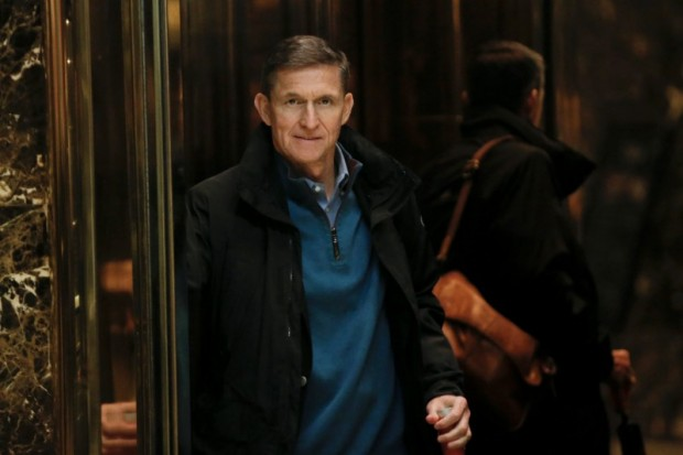 Retired U.S. Army Lieutenant General Michael Flynn boards an elevator as he arrives at Trump Tower where U.S. President-elect Donald Trump lives in New York