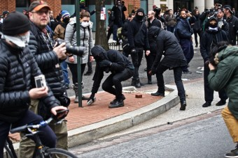 Bricks being pulled from the sidewalk on K steet during the protest - Daily Caller - Grae Stafford
