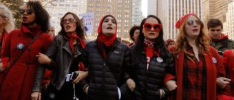 Organizers Linda Sarsour (C), Carmen Perez (2nd R) and Bob Bland (R) lead during a 'Day Without a Woman' march on International Women's Day in New York, U.S., March 8, 2017. REUTERS/Lucas Jackson