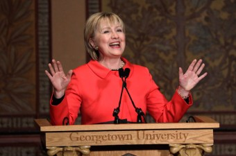 Former secretary of state Hillary Clinton reacts after being introduced to speak at an awards ceremony honoring women and their role in international politics and peace building efforts hosted by the Georgetown Institute for Women, Peace and Security in Washington, March 31, 2017. REUTERS/Kevin Lamarque