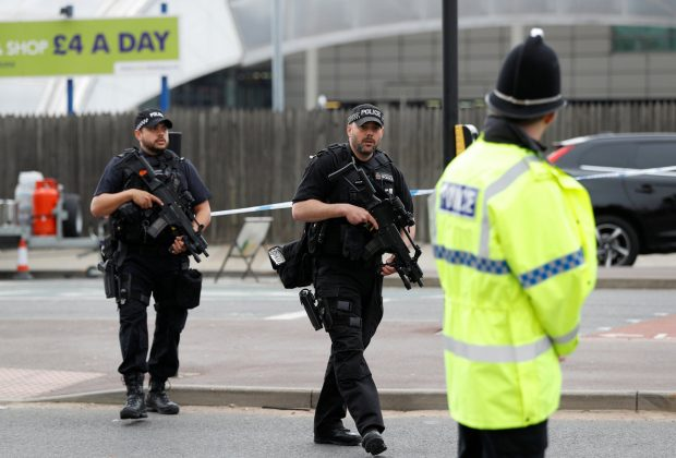 Armed police stand near the Manchester Arena in Manchester, Britain May 24, 2017. REUTERS/Peter Nicholls