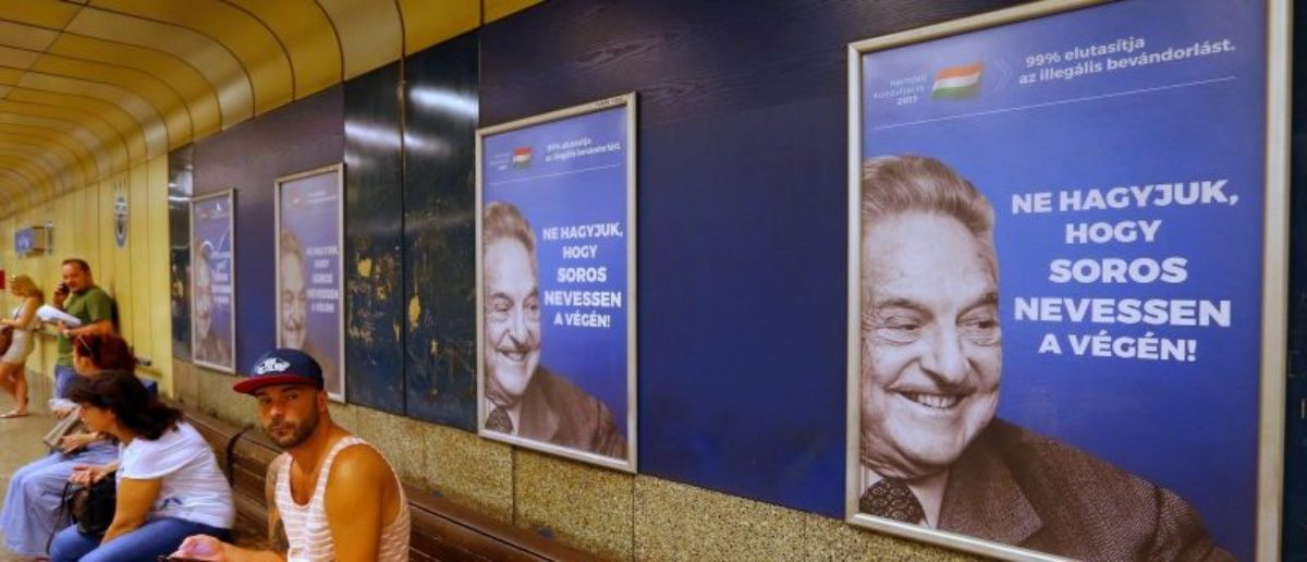"""Hungarian government poster portraying financier George Soros and saying """"Don't let George Soros have the last laugh"""" is seen at an underground stop in Budapest, Hungary July 11, 2017. REUTERS/Laszlo Balogh"""