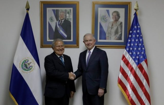 El Salvador's President Salvador Sanchez Ceren (L), shakes hands with U.S. Attorney General Jeff Sessions during a visit in San Salvador, El Salvador, July 27, 2017. Presidency El Salvador/Handout via Reuters