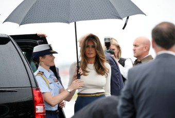 U.S. First Lady Melania Trump has an umbrella held for her as she steps from Air Force One with U.S. President Donald Trump upon their arrival in Newark, New Jersey, U.S. to spend the weekend in Bedminster July 14, 2017. REUTERS/Kevin Lamarque - RTX3BIOG