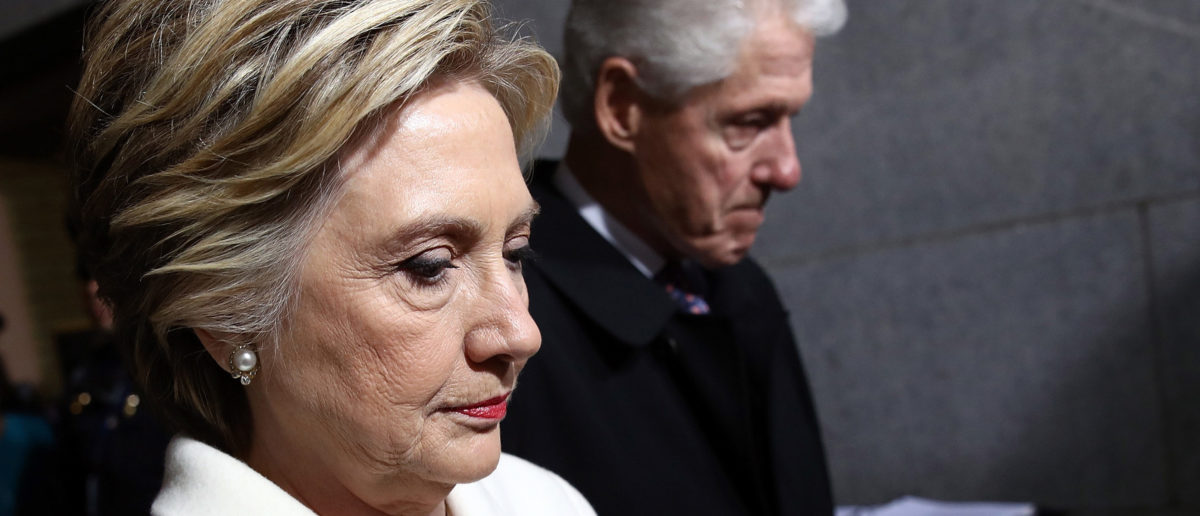 Former Democratic presidential nominee Hillary Clinton (L) and former President Bill Clinton arrive on the West Front of the U.S. Capitol in Washington, D.C., U.S., January 20, 2017. REUTERS/Win McNamee/Pool