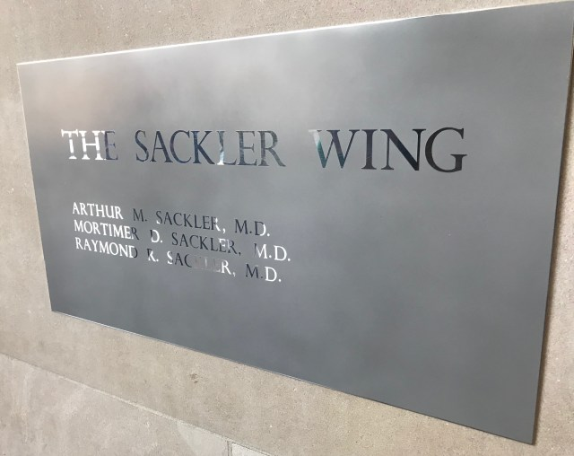 A plaque listing the three Sackler brothers who funded the Sackler Wing at the Metropolitan Museum of Art in New York City (DCNF/Ethan Barton)