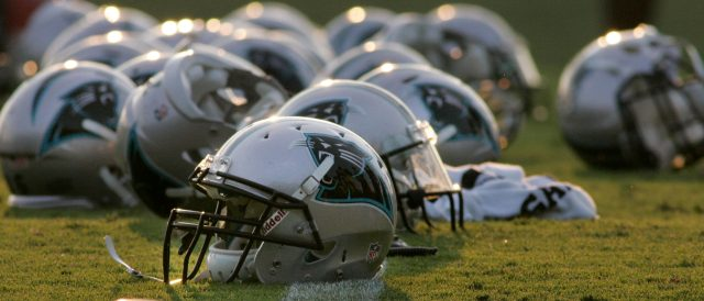 Carolina Panthers helmets are pictured on the field as players work out on their first day in pads at the NFL training camp at Wofford College in Spartanburg, South Carolina August 1, 2011.  REUTERS/Mary Ann Chastain