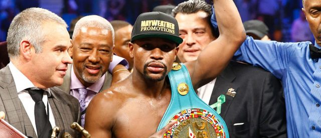 Floyd Mayweather Jr. celebrates the unanimous decision victory during the welterweight unification championship bout on May 2, 2015 at MGM Grand Garden Arena in Las Vegas. (Photo by Al Bello/Getty Images)
