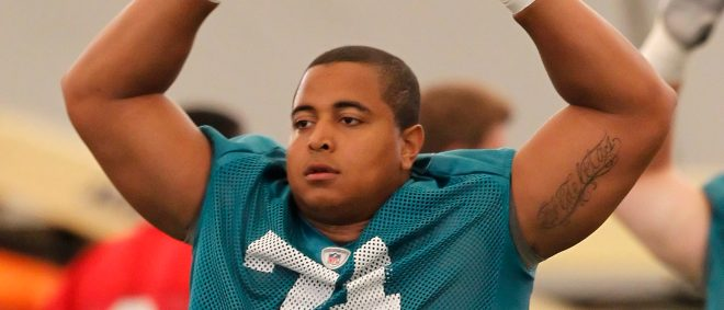 DAVIE, FL - MAY 4: Jonathan Martin #71 of the Miami Dolphins warms up prior to the rookie minicamp on May 4, 2012 at the Miami Dolphins training facility in Davie, Florida. (Photo by Joel Auerbach/Getty Images)