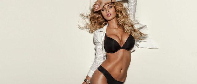 Sexy elegant blonde woman posing in lingerie in studio. Long curly hair. Sensual look. Fit body Shutterstock/  PawelSierakowski